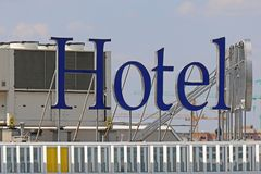 Hotel sign on top of building Stock Image
