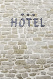 Hotel sign on a wall Royalty Free Stock Photo