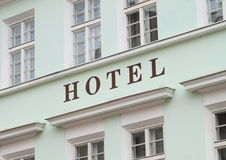 Hotel. Sign of hotel with windows around Royalty Free Stock Images