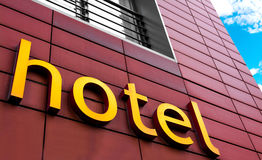 Hotel Sign. Hotel written on a burgundy building Stock Image