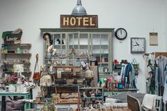 Hotel Signage on Top of Gray Wooden Cabinet Royalty Free Stock Image