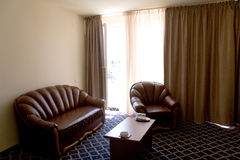 Hotel sitting room. Modern design, armchair, coffee table Royalty Free Stock Image