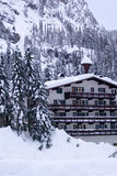 Hotel in snow vertical. A hotel located in mountains covered by deep snow Stock Photography