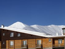 Hotel in snow at winter mountains Royalty Free Stock Images