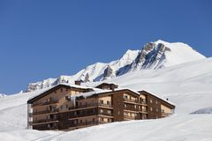 Hotel in snowy mountains Stock Image