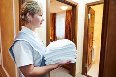 Hotel staff at room cleaning and housekeeping Royalty Free Stock Photo