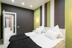 Hotel standart room. modern bedroom with white pillows. simple and stylish interior. interior lighting stock photos