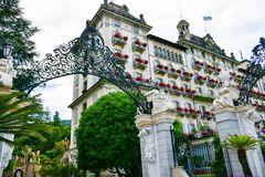 Hotel in Stresa on Maggiore Lake,  Italy. Grand Hotel  Grand Hotel des Iles Borromees.in Stresa. View from the Maggiore Lake  Ernest Hemingway visited the town Royalty Free Stock Photos