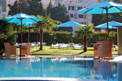 Hotel Swimming Pool. Luxurious open air swimming pool at resort Royalty Free Stock Photo