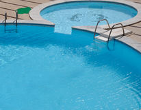 Hotel swimming pool in the back yard Royalty Free Stock Photo