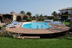 Hotel swimming pool in the back yard Royalty Free Stock Photography