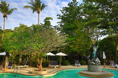 The hotel swimming pool, beach and trees, Phra Ae Beach, Ko Lanta, Thailand Royalty Free Stock Photo