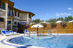 Hotel with swimming pool. Courtyard with a swimming pool in the open air Royalty Free Stock Photography