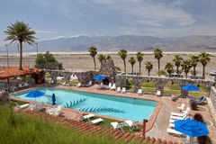 Hotel swimming pool and desert royalty free stock photo