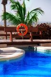 Hotel swimming pool and lifebuoy royalty free stock photography