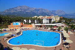 Hotel and swimming pool on a mountain background. Kemer. Turkey. Territory of a luxury hotel wiht a big swimming pool on a mountains background. Kemer, Turkey Royalty Free Stock Photo