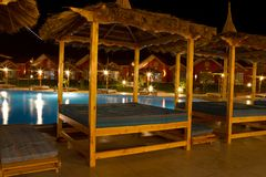 Hotel swimming pool at night Royalty Free Stock Image