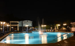 Hotel swimming pool at night Stock Photo