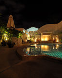 Hotel swimming pool at night Royalty Free Stock Images