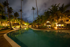 Hotel swimming pool at night Stock Images