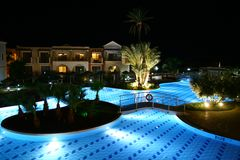Hotel swimming pool by night Royalty Free Stock Photo