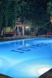 Hotel swimming pool with night illumination Idyros, Kemer, Turkey Royalty Free Stock Images