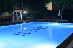 Hotel swimming pool with night illumination Idyros, Kemer, Turkey Stock Image