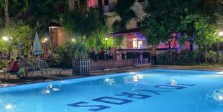 Hotel swimming pool with night illumination Idyros, Kemer, Turkey Stock Photo