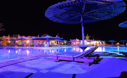 Hotel swimming pool at night Royalty Free Stock Photo