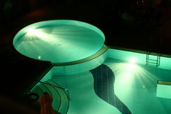 Hotel swimming pool by night Stock Photography