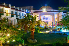 Hotel with a swimming pool and palm trees, Egypt. Night view. Stock Photos