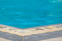 Hotel swimming pool with sunny reflections Royalty Free Stock Photography