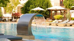 Hotel swimming pool with water fountain Stock Photos