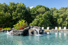 Hotel swimming pool with waterfall stock photos