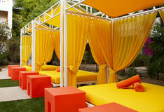 Hotel Swimming and Wading Pool. Very colorful chaise lounges and umbrellas surround a modern desert hotel resort pool Stock Photography