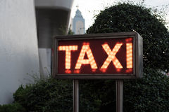 Hotel Taxi Sign Light Box. With Orange Lights Royalty Free Stock Image