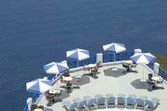 Hotel terrace. A beautiful arrangement of tables with umbrellas on a hotel terrace in Greece Stock Image