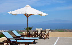 Hotel terrace at Aegean Sea. Hotel terrace with sun umbrella and chairs stock images