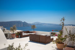 Hotel terrace in Santorini. Hotel terrace with sofas . Beautiful view at the seaside. Santorini, Greece Royalty Free Stock Images