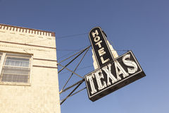 Hotel Texas in Fort Worth, USA. FORT WORTH, USA - APR 6: Hotel Texas sign in the Fort Worth Stockyards historic district. April 6, 2016 in Fort Worth, Texas, USA Royalty Free Stock Photo