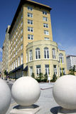 Hotel with three large sphere sculptures in foreground Royalty Free Stock Image