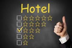 Hotel thumbs up rating three stars. Hotel check thumbs up rating three stars stock images