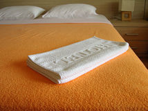 Hotel towels on the bed. Hotel room with white towels on the bed Stock Photography