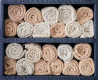 Hotel towels rolled in shelf. royalty free stock images