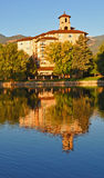 The Hotel Tower and trees at the Five Star Broadmoor Hotel at Colorado Springs. Reflecting off of a calm lake, the Broadmoor hotel stands majestically Stock Photo