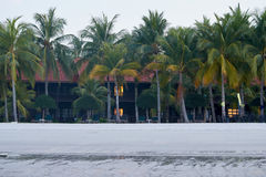 Hotel Tropical framed by palm trees and white sand Royalty Free Stock Photo