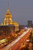 Hotel Ukraine at Kutuzov Avenue in evening Stock Photos