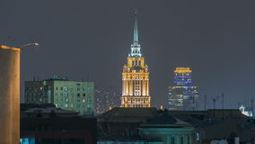 Hotel Ukraine with roofs timelapse, landmark near historic center of Moscow. Cityscape in snowy winter evening. Panorama top view on city at night stock video