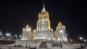 Hotel Ukraine winter night timelapse hyperlapse. Hotel Ukraine Taras Shevchenko monument winter night timelapse hyperlapse - one of the seven sister skyscrapers stock video footage