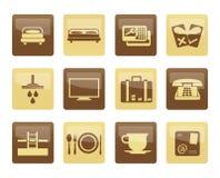 Hotel- und Motelikonen über braunem Hintergrund Lizenzfreies Stockfoto